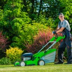 Man mowing lawn, tackling the most common lawncare mistakes in Arizona